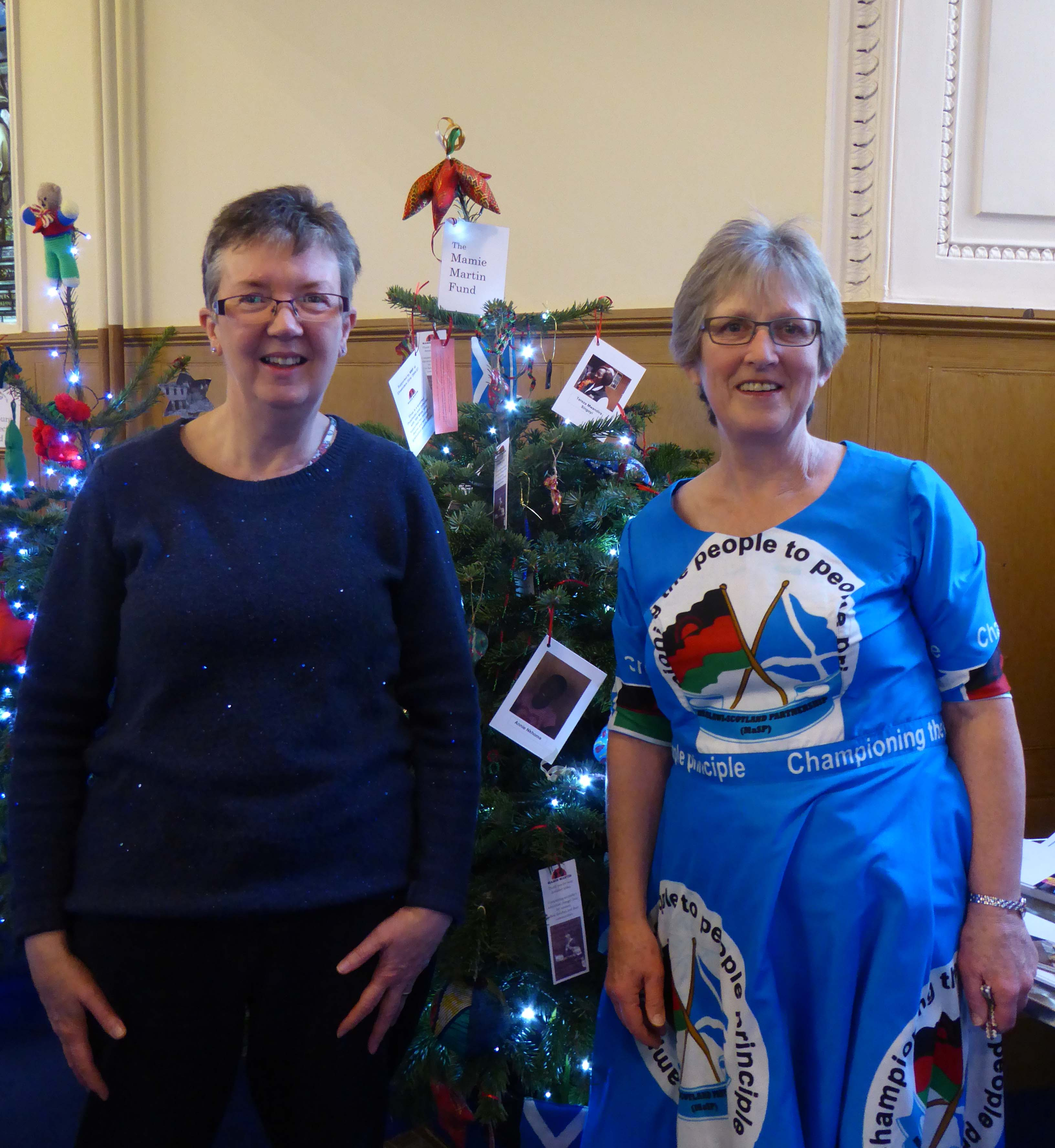 Two women and Christmas tree
